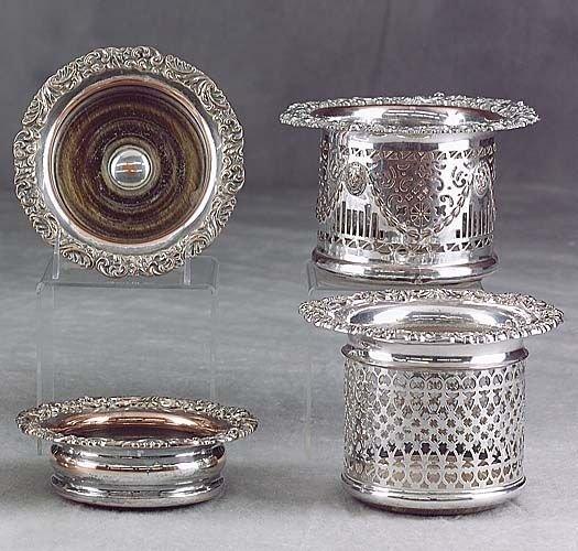 423: Four silverplate wine coasters