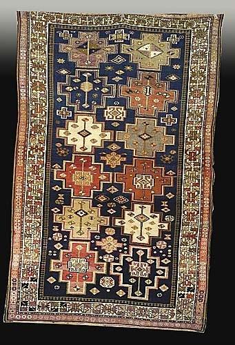 616: Antique Kuba carpet