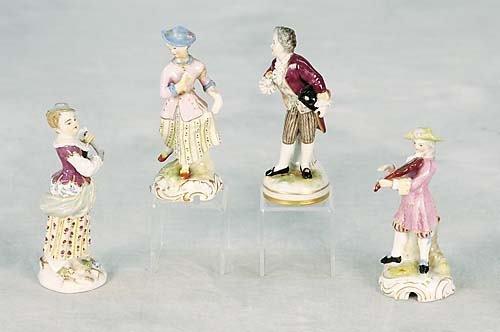 012: Four miniature porcelain figures   romantic pair,
