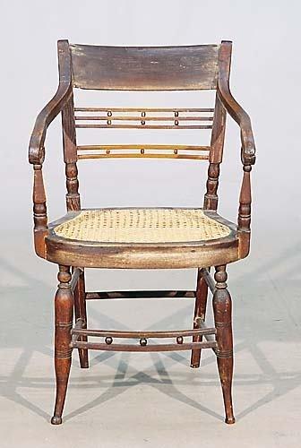 443: Late Sheraton oak and cane armchaircirca 1810shape