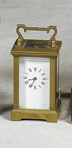 018: Small carriage clock circa 1900 brass case with ha