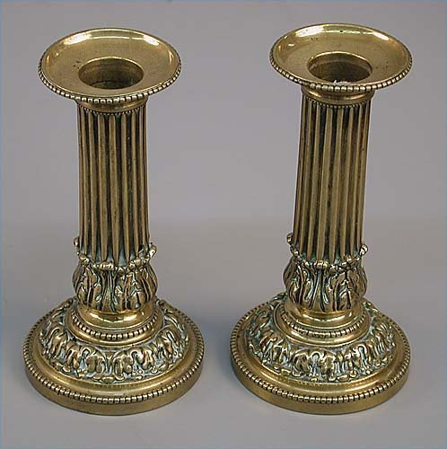 9: Pair of Georgian style single brass candle