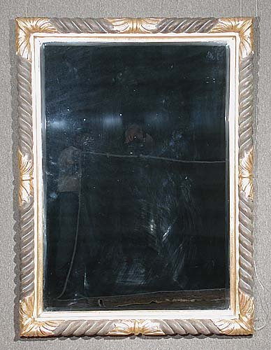 24: Parcel gilt and painted framed mirror