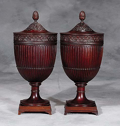 Pair of Adam style carved mahogany urns
