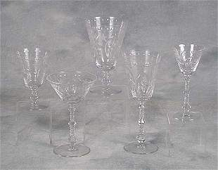 Cut and etched glass stemware consisting