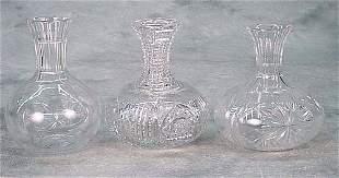 Three cut-glass carafe each with elongat