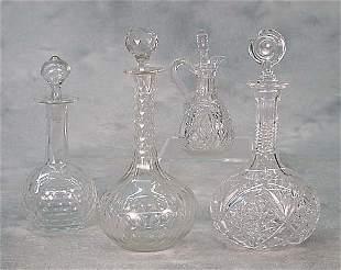 Four cut-glass decanters and cruet three