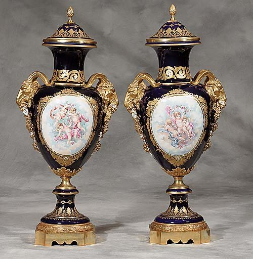 591: Pair of Sevres style porcelain urns each
