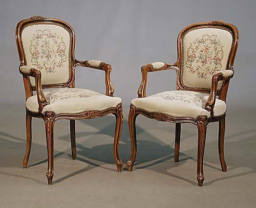 002: Pair Louis XV style armchairs
