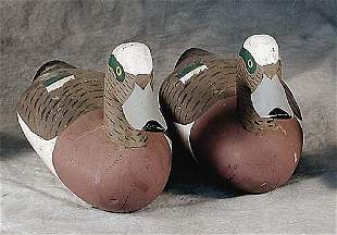 Two carved and polychrome wood duck deco