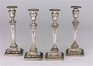Four Adam style silverplate candlesticks