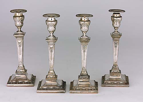 433: Four Adam style silverplate candlesticks