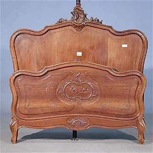 Louis XV style carved walnut bed circa 1