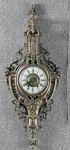 023: French brass wall clock first quarter of
