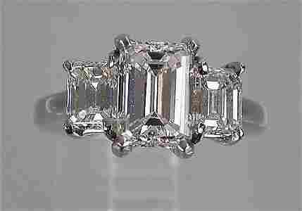 178: Platinum and diamond ring three stone ri