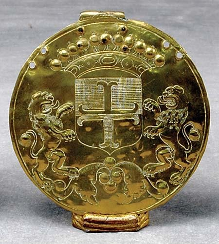 9: English worked brass plaque