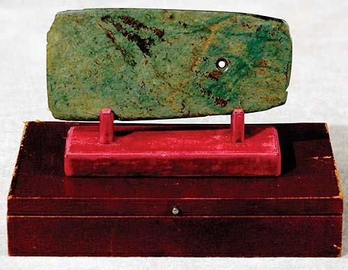 13: Ancient polished stone ax head