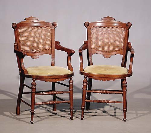 009: Pair Victorian Eastlake walnut and caned-back armc