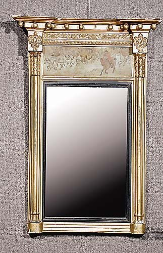 021: Regency carved giltwood looking glass 19th century