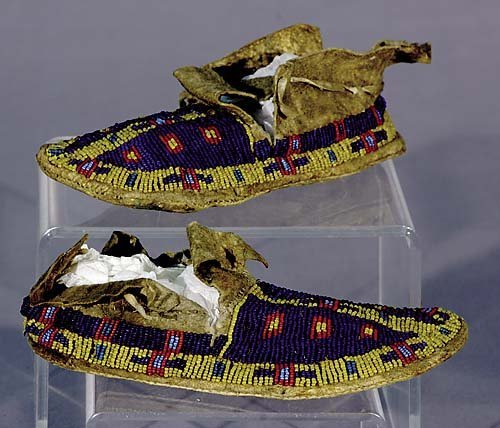 415: Native American moccasins early 20th century hide