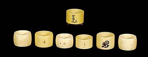 418: Seven bone and faux ivory napkin rings circa 1900