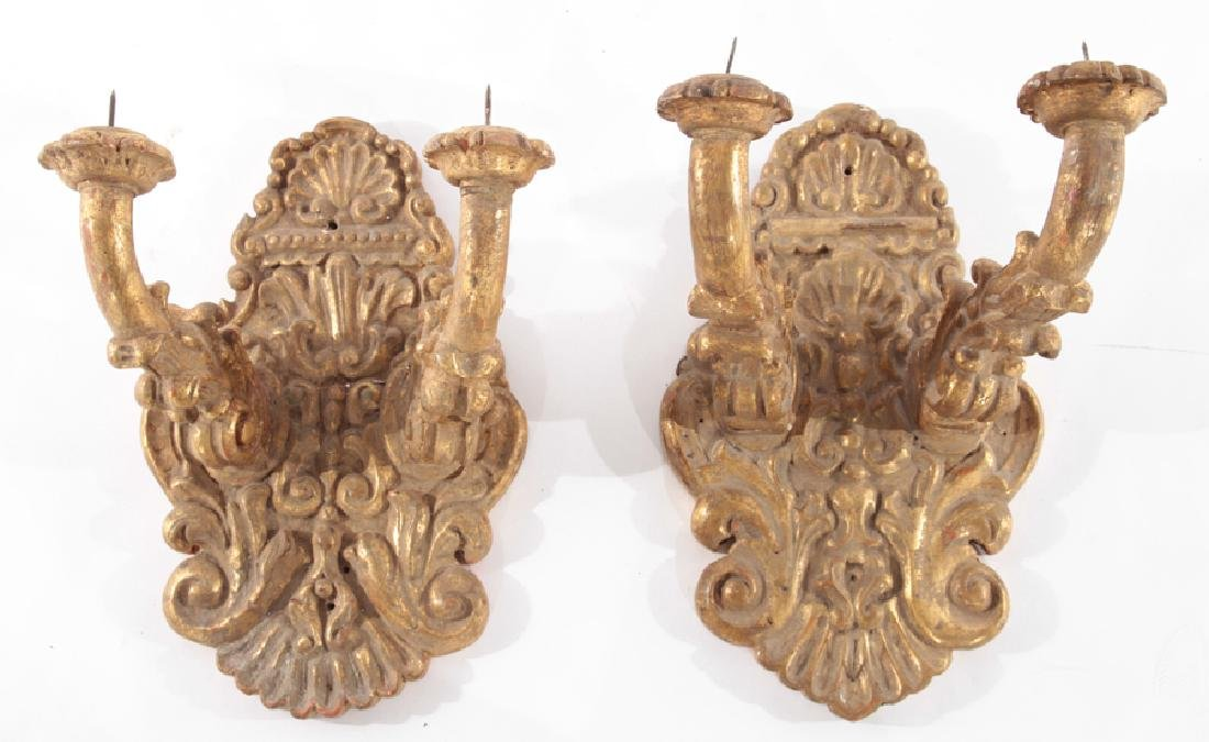 PAIR OF CONTINENTAL CARVED GILTWOOD SCONCES