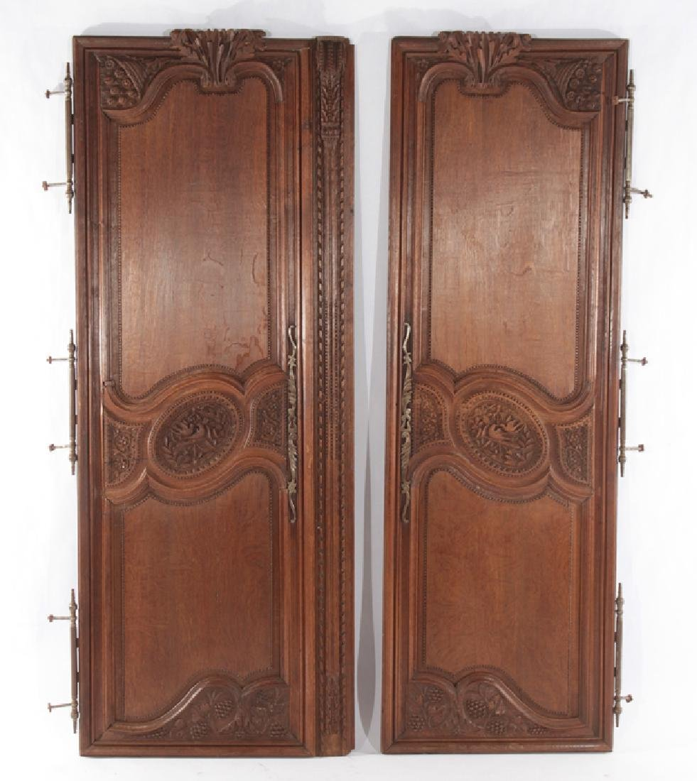 PAIR OF FRENCH 19TH CENT. CARVED OAK DOORS