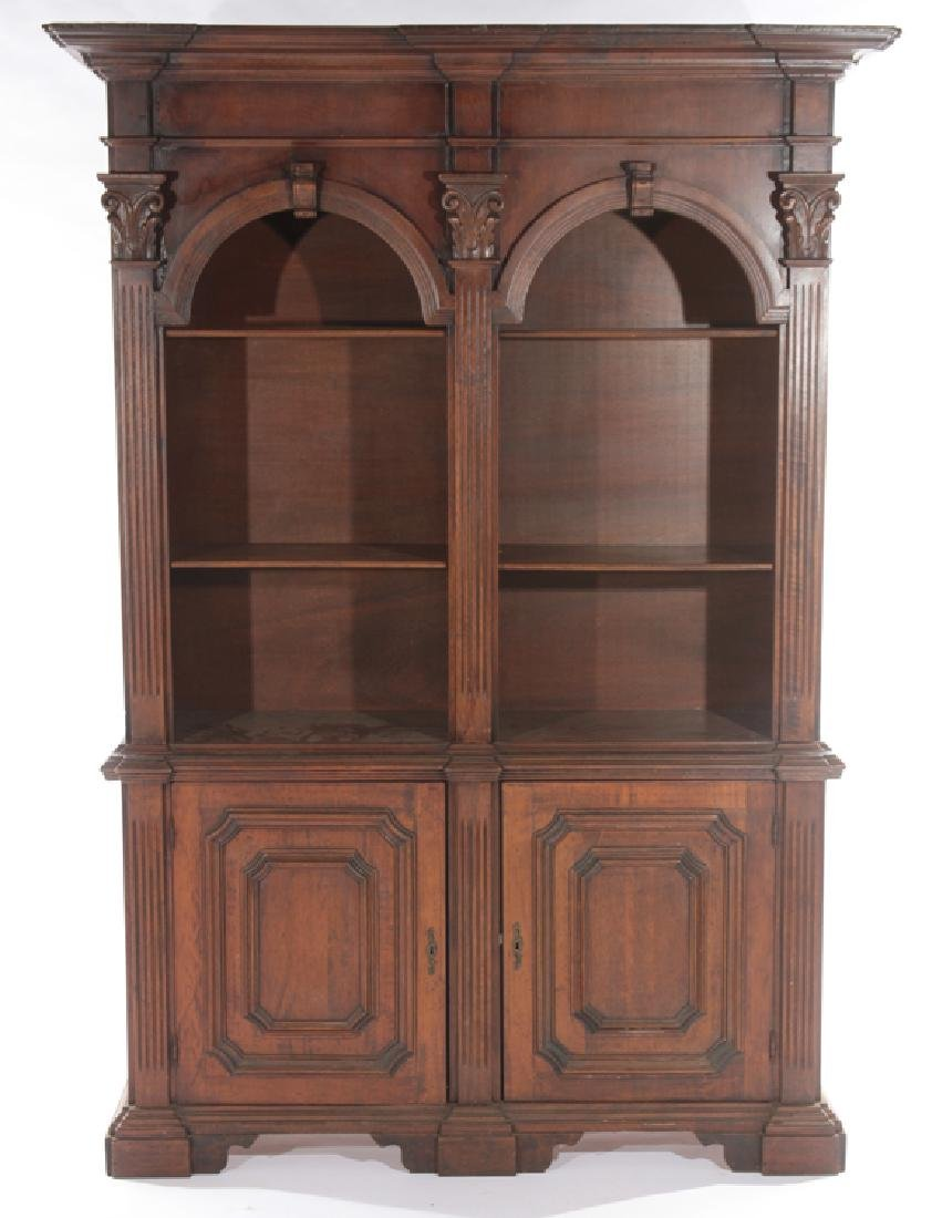 A CARVED WOOD 2-PART BOOKCASE ITALIAN