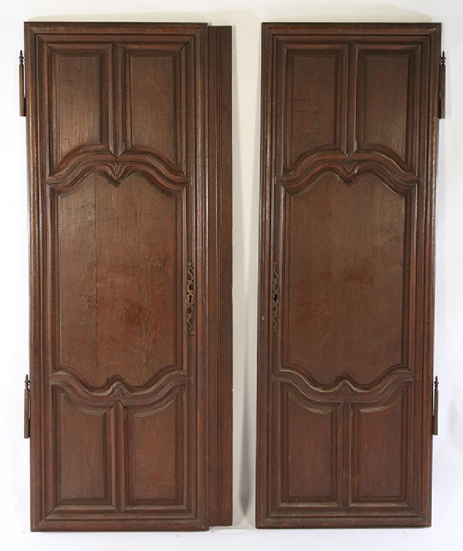 PAIR 19TH C. FRENCH CARVED WALNUT DOORS