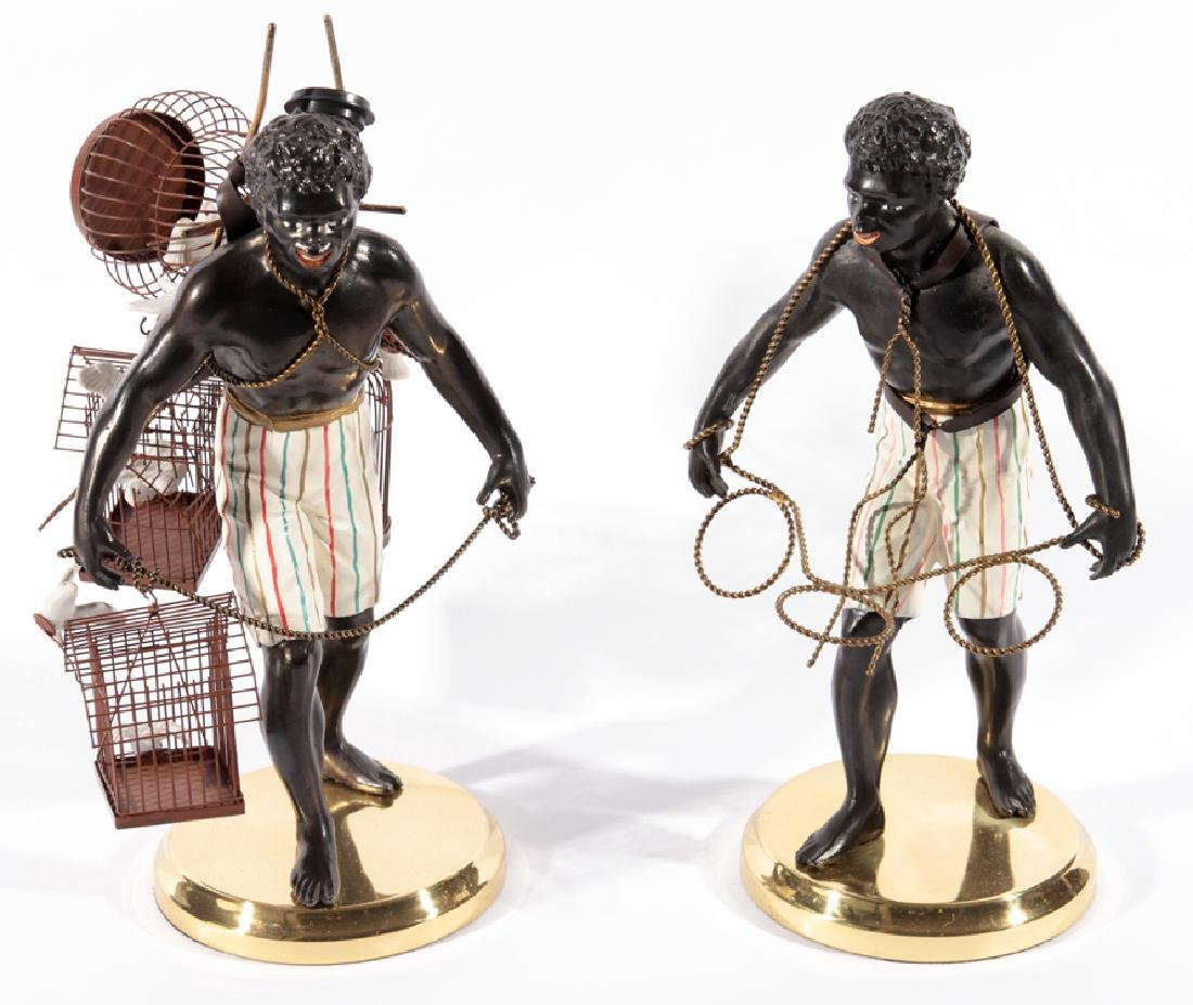 PAIR OF BLACKAMOORE FIGURINES ATOP BRASS STANDS