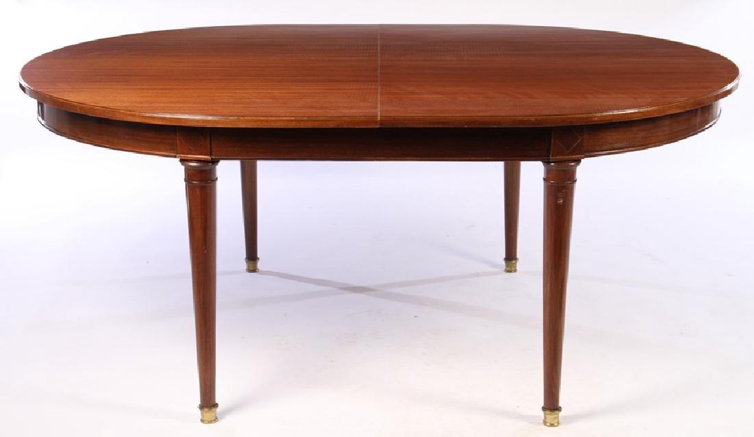 A MAHOGANY OVAL DINING TABLE BRONZE SABOTS C.1940 - 2