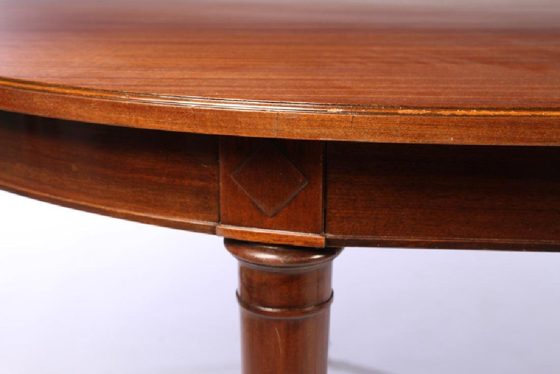 A MAHOGANY OVAL DINING TABLE BRONZE SABOTS C.1940 - 4