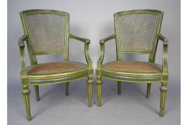 PAIR OF 18TH CENTURY POLYCHROME CANED OPEN ARM CHAIRS