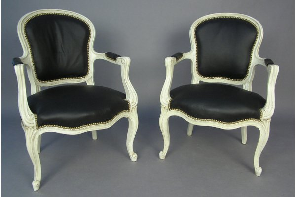 PAIR OF GENEROUSLY PROPORTIONED OPEN ARM CHAIRS