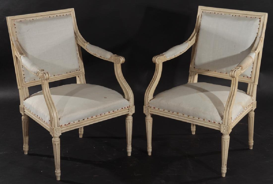 PAIR LOUIS XVI STYLE CARVED OPEN ARM CHAIRS C1910