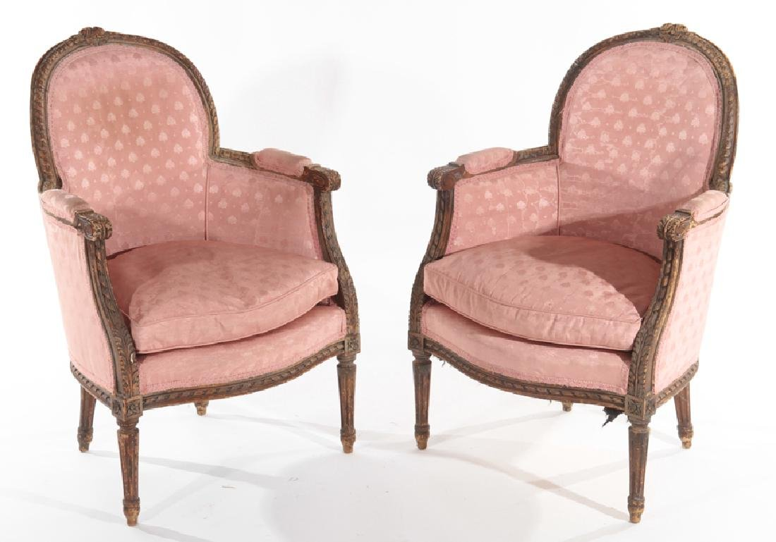 PAIR CARVED LOUIS LXVI STYLE BERGERE CHAIRS C1910