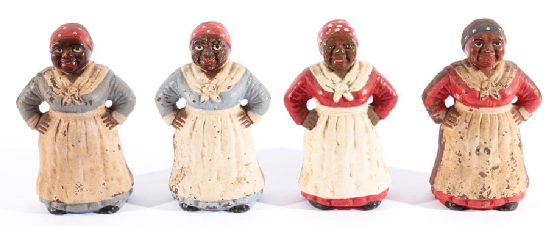 4 POLYCHROMED CAST IRON AUNT JEMIMA FIGURES