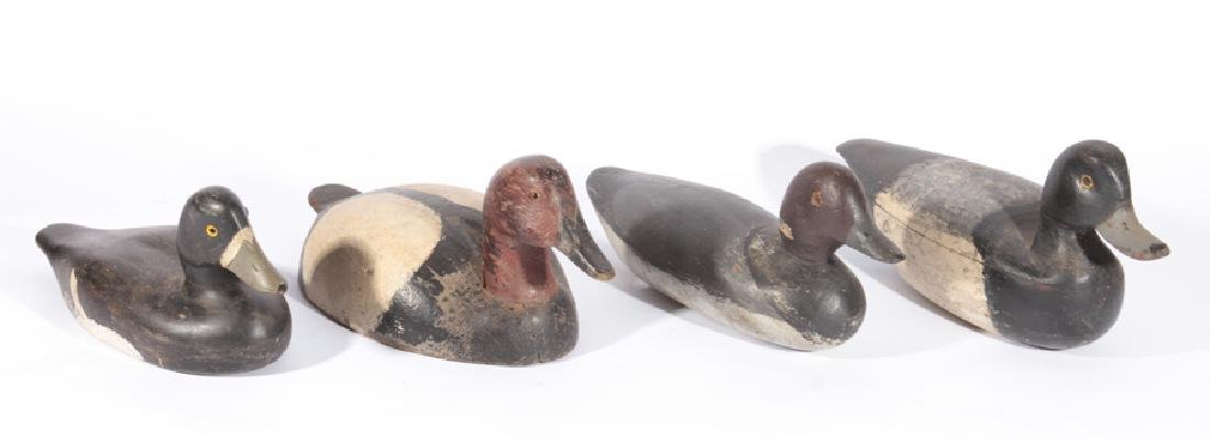 GROUP OF 4 CARVED AND POLYCHROMED DUCK DECOYS