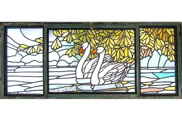 1021: HANDPAINTED AND LEADED GLASS WINDOW OF TWO SWANS
