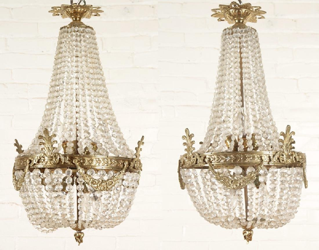 PAIR OF BRONZE AND CRYSTAL EMPIRE STYLE CHANDELIERS