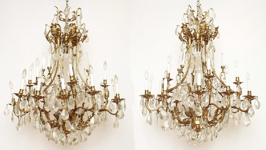 PAIR BRONZE CRYSTAL FIGURAL CAGE FORM CHANDELIERS