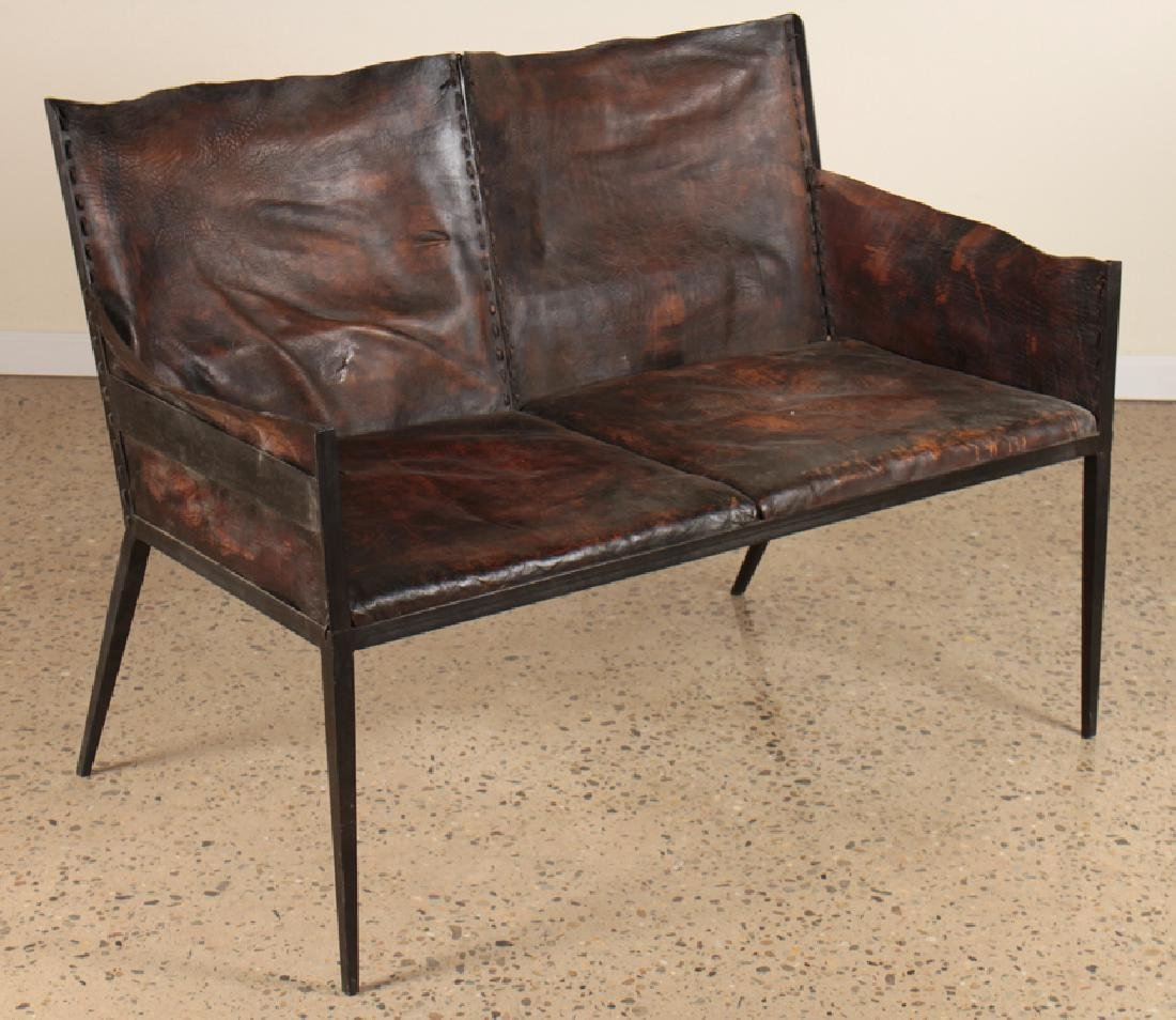 IRON LEATHER SETTEE MANNER OF JEAN-MICHEL FRANK