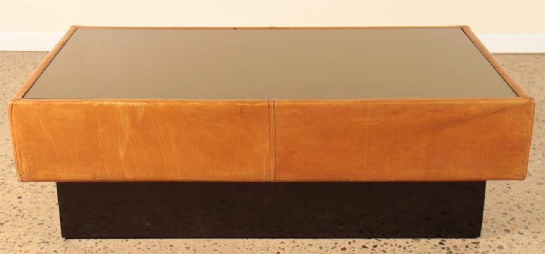 A FRENCH MID CENTURY MODERN LEATHER COFFEE TABLE