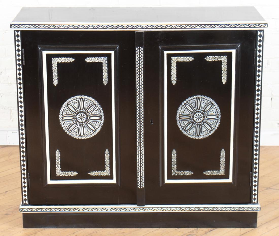CARVED EBONIZED CABINET MANNER OF FORNASETTI