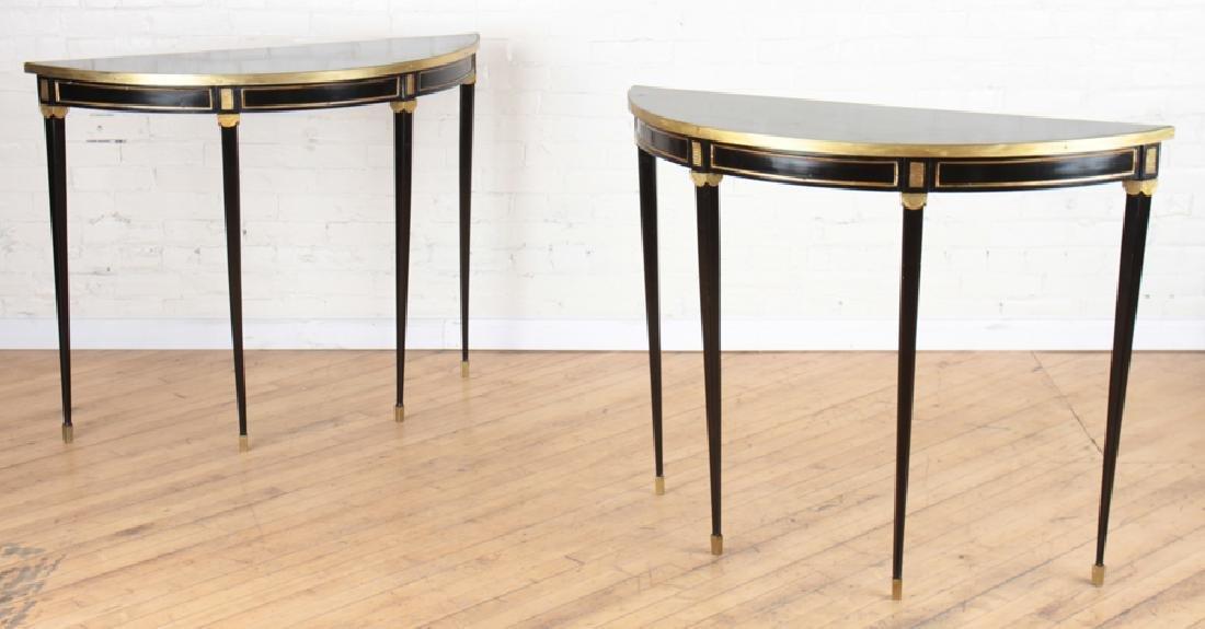 PAIR EBONIZED DEMILUNE CONSOLE TABLES