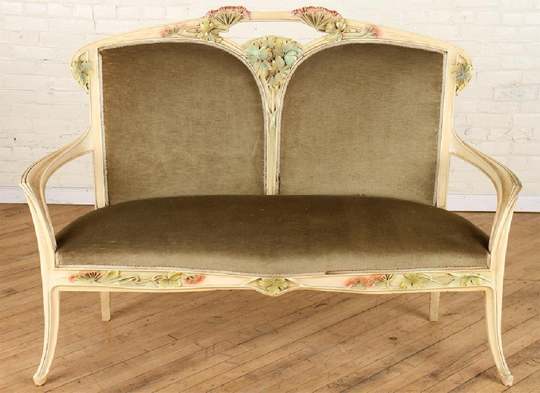 A PAINTED ART NOUVEAU LOUIS MAJORELLE UPHOLSTERED SOFA