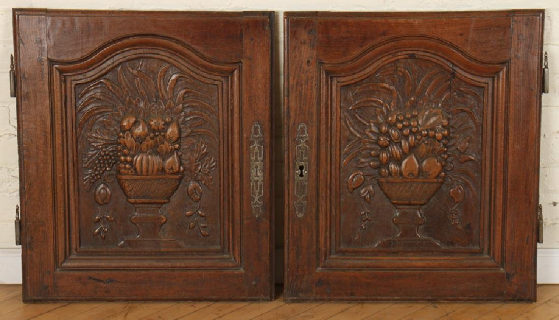 A  PAIR OF CARVED MAHOGANY DOORS CIRCA 1870.