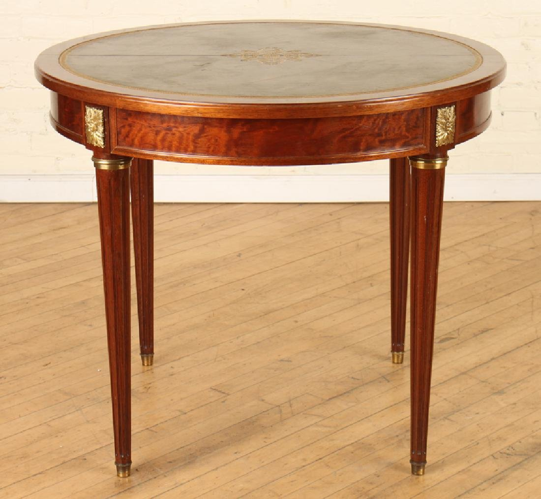 ROUND FLAME MAHOGANY DINING TABLE