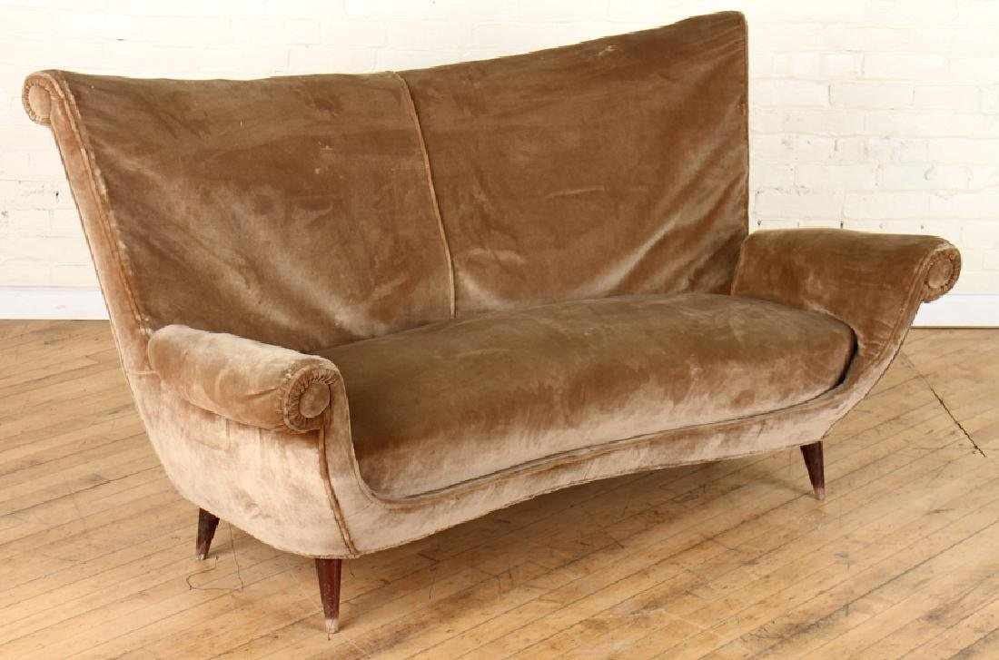 AN ITALIAN SOFA WINGED ARMS C. 1950