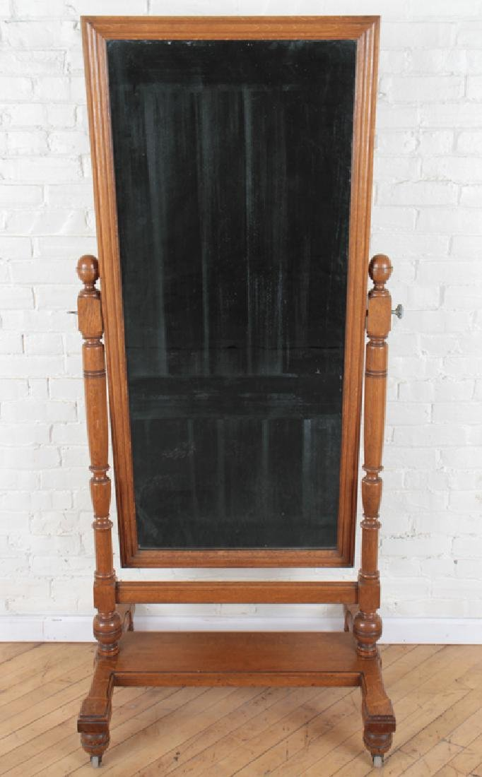 ADJUSTABLE OAK CHEVAL MIRROR ON WHEELS C. 1910